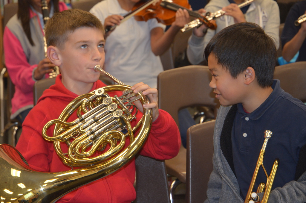 File photo: Anaheim City School District elementary students test out their instruments. The district now plans to offer music classes to all of its students.