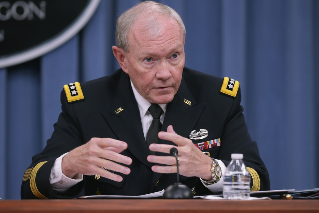 Former Chairman of the Joint Chiefs of Staff Gen. Martin Dempsey answers reporters' questions during a news conference at the Pentagon October 30, 2014 in Arlington, Virginia.