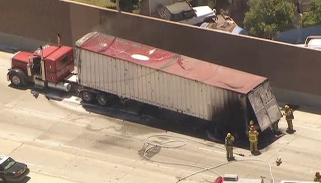 Firefighters are tending to a big rig burning on the 5 Freeway Monday afternoon in Burbank.