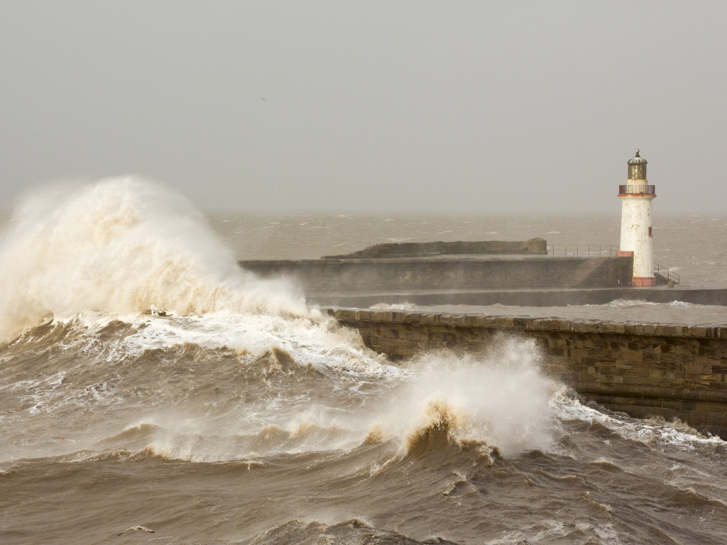 High tide storm waves batter the Cumbrian coast, completely inundating the harbor wall at Whitehaven on Monday.