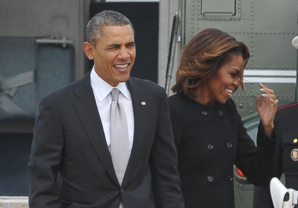 US President Barack Obama and First Lady Michelle Obama make their way to board Air Force One on March 7, 2014 at Andrews Air Force Base in Maryland. Obama was heading to Florida where he is scheduled to speak at a high school and to spend the weekend with his wife.