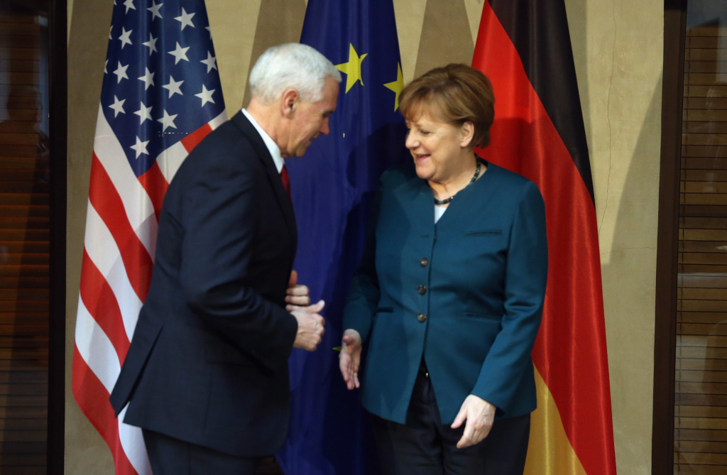 U.S. Vice President Mike Pence (L) and German chancellor Angela Merkel shake hands at the 2017 Munich Security Conference on February 18, 2017 in Munich, Germany.