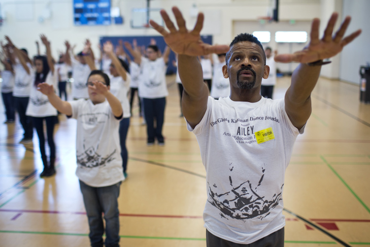 Teaching artist Michael Thomas takes part in leading almost 100 students during the four-day Alvin Ailey Revelations Residency at Rancho Dominguez Preporatory School in Long Beach on Thursday, March 12, 2015.