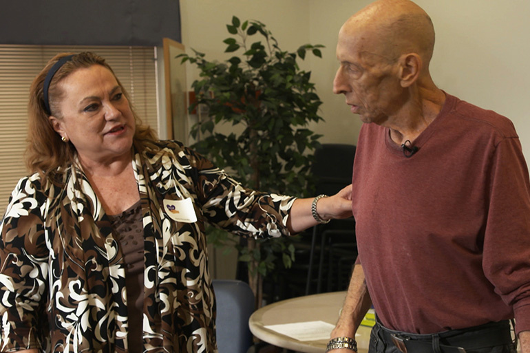 An actor (right), trained to play a patient with advanced Alzheimer's disease, role plays with a participant at UCLA Health's Alzheimer's Caregiver Boot Camp.