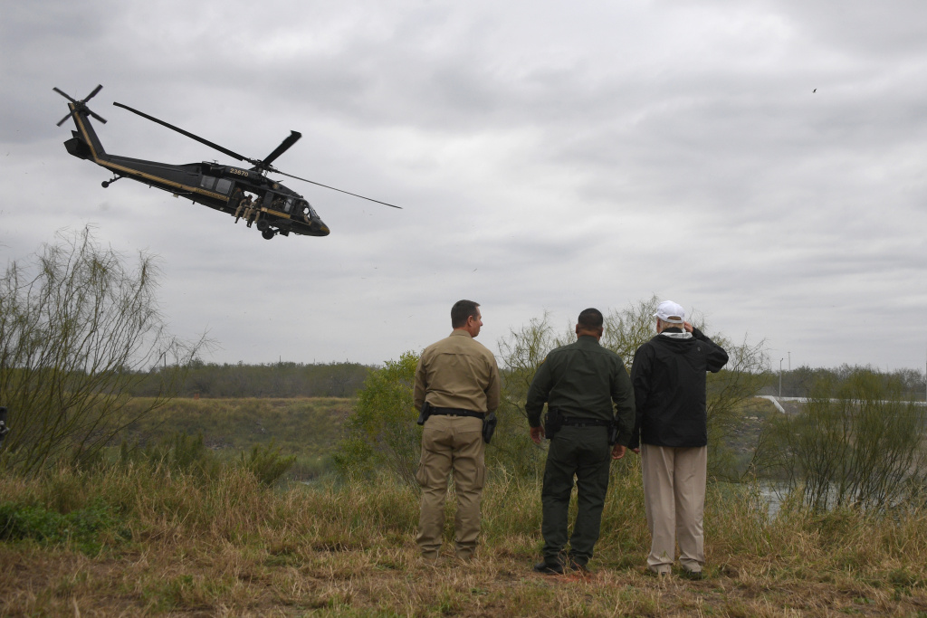 President Trump with Border Patrol agents at the Rio Grande as a Customs and Border Protection helicopter flies over near McAllen, Tex., on Jan. 10, 2019.