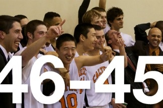 Cal Tech men's basketball team celebrates their one-point win over Occidental College.