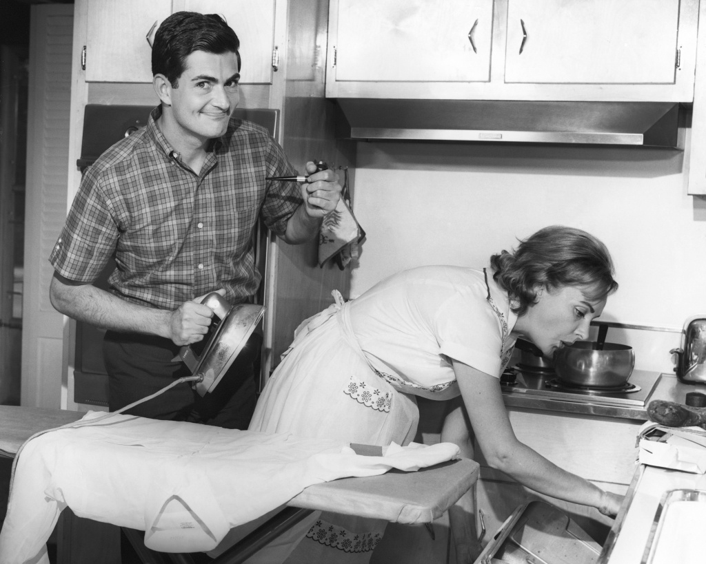 UNITED STATES - CIRCA 1950s: Couple doing domestic chores.