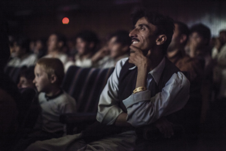 Moviegoers watch a Pakistani film at Pamir Cinema in the old city of Kabul, November 2010.