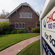 """LOS ANGELES, CA - NOVEMBER 27:  A """"For Sale"""" sign is posted in front of a house on November 27, 2012 in Los Angeles, California."""