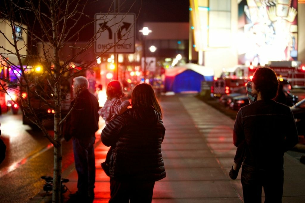 People stand outside the Clackamas Town Center after a shooting on Dec. 11, 2012 in Clackamas, Oregon.
