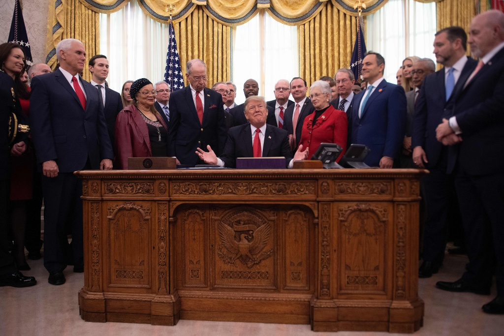 US President Donald Trump speaks prior to signing the First Step Act and the Juvenile Justice Reform Act at the White House in Washington, DC, on December 21, 2018.