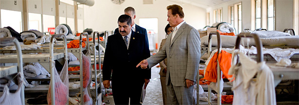 California Governor Arnold Schwarzenegger (R) tours the California Institution for Men prison with Warden Aref Fakhoury (L) on August 19, 2009 in Chino, California.