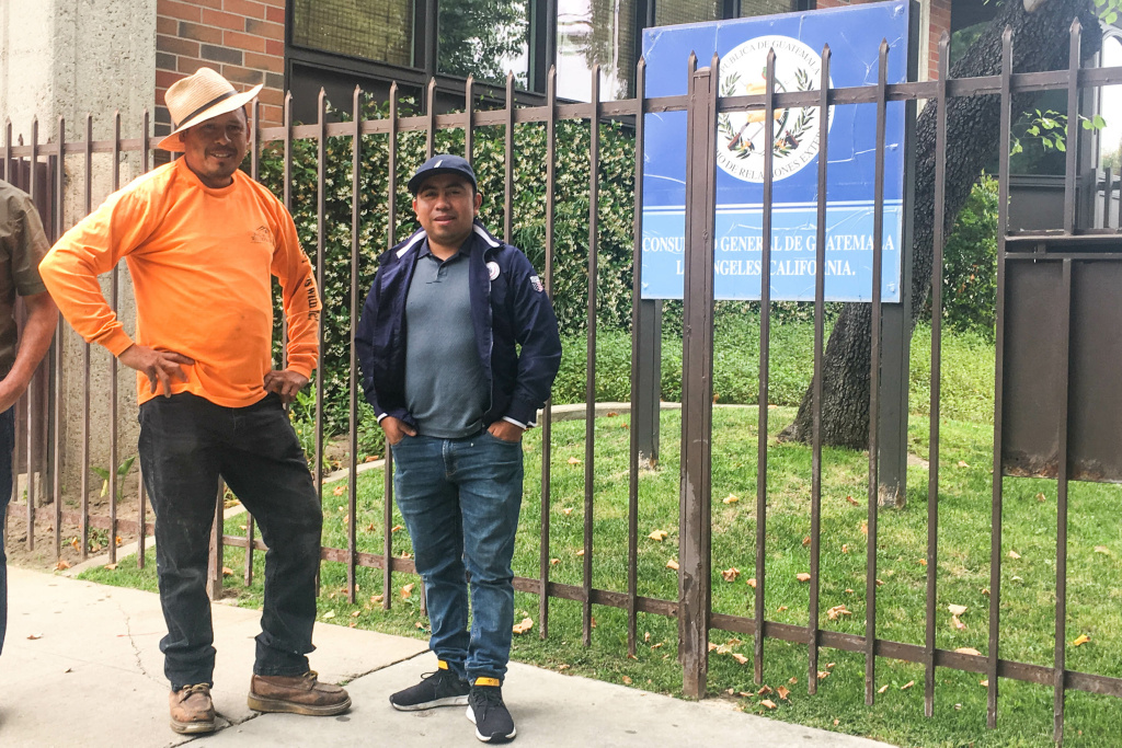 Guatemalan nationals Adrián de Jesús Álvarez (left) and Victor Manuel Ixtos (right) stand outside Guatemala's Los Angeles consulate on the Friday before national elections.