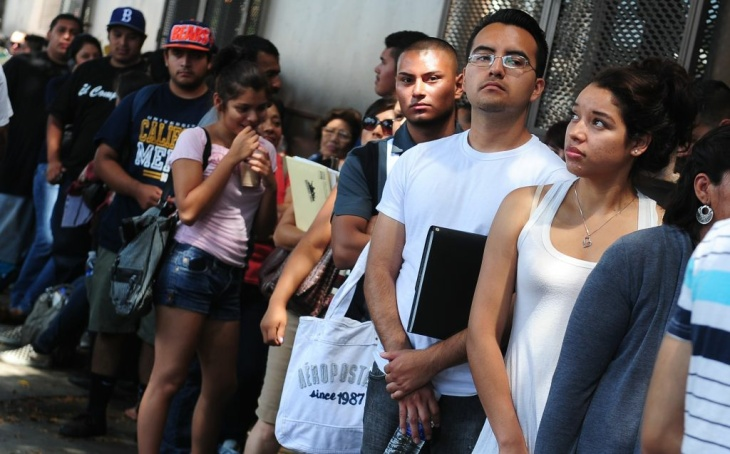 Young people wait in line to enter the o