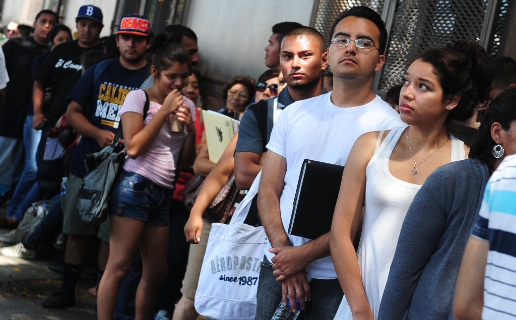Young people wait in line to enter the office of The Coalition for Humane Immigrant Rights of Los Angeles (CHIRLA) on August 15, 2012 in Los Angeles, California, on the first day of the Deferred Action for Childhood Arrivals (DACA) program. US authorities began taking applications for deferred deportations from undocumented immigrants brought here as children, an initiative that could benefit up to 1.7 million people, as long lines of applicants, many who have long feared separation from their families and deportation from the country they've always considered home, formed outside consulates, advocacy offices and law firms.