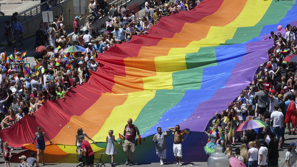 Marchers carry an LGBTQ pride flag during the Utah Pride Parade in Salt Lake City in June.