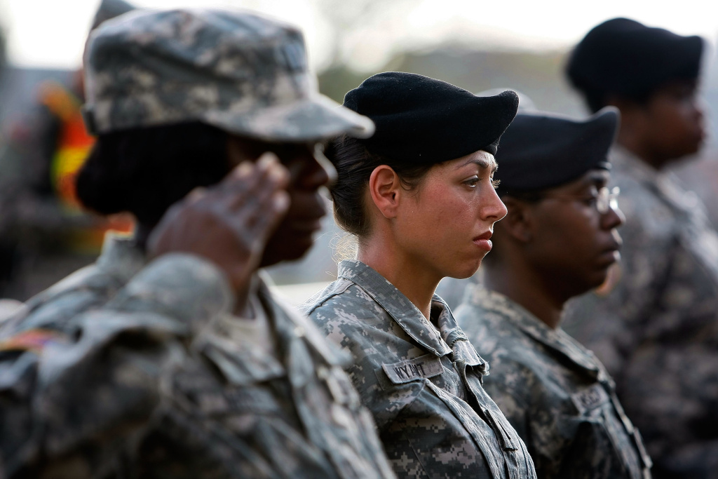 File: U.S. Army soldiers stand together as they salute during the memorial service.