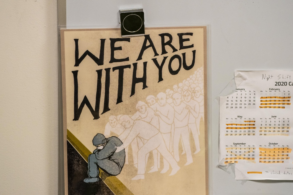 Artwork posted by a chaplain is seen in a break room in the trauma surgery ICU at Harborview Medical Center on November 26, 2020 in Seattle, Washington.