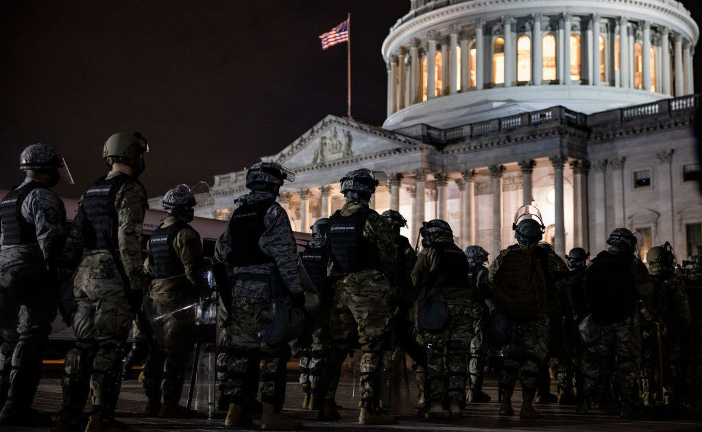 Members of the National Guard and the Washington, D.C., police stand guard outside the U.S. Capitol on Jan. 6, after a pro-Trump mob stormed the complex.