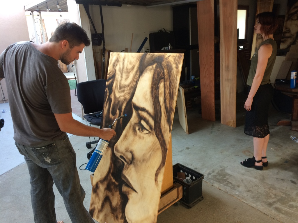 Zachary Aronson works on a portrait of a live model in his studio in Mar Vista.