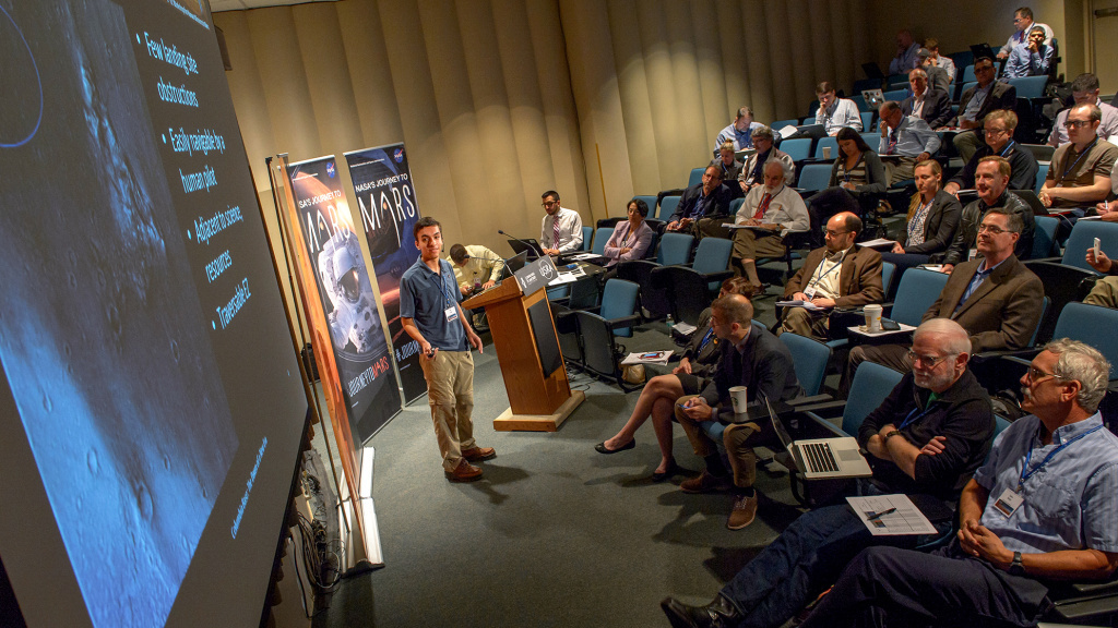 Alex Longo makes a pitch at the Lunar and Planetary Institute in Houston, Texas, in October 2015. The Institute sponsored the conference to pick a landing site for the first human landing on Mars. Long has proposed a site for a different mission — a rover landing.