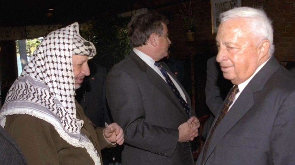 Ariel Sharon, who was Israel's foreign minister in 1998, negotiated with Palestinian leader Yasser Arafat at the Wye River Plantation, Md. They reached a limited  agreement, but Sharon refused to shake hands with Arafat, his life-long rival. This is one of the few photos showing them together.