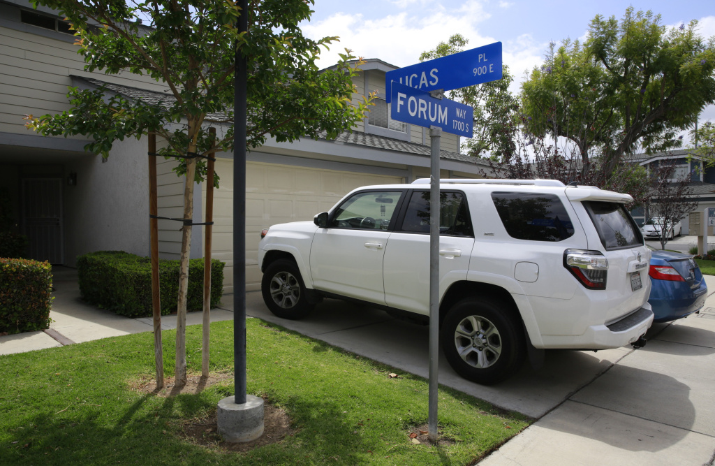 File: Vehicles are parked outside the home of Syed Raheel Farook, the elder brother of San Bernardino gunman Syed Rizwan Farook, after the FBI served a warrant to the location, in Corona, Calif., Thursday, April 28, 2016.