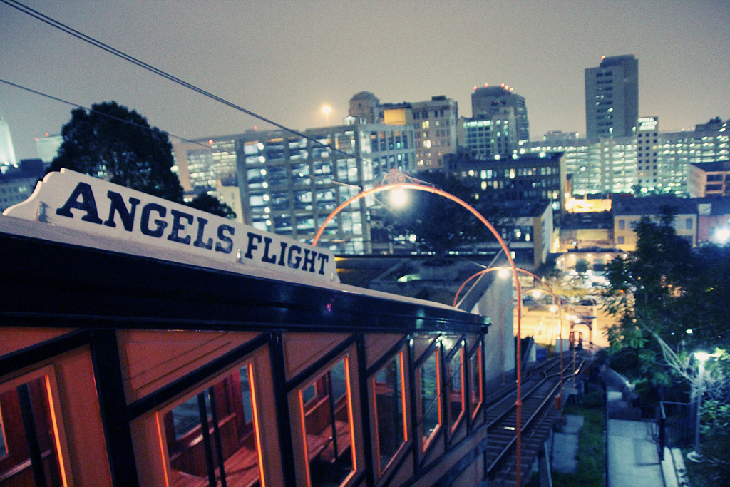 Angels Flight with the downtown Los Angeles skyline in the background.