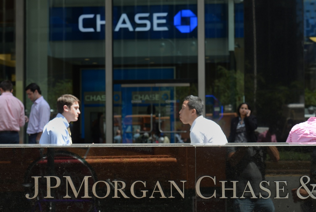People walk by JP Morgan Chase & Company headquarters in New York, August 14, 2013. The US August 14, 2013 charged a pair of former JPMorgan Chase traders with fraud in connection with the 2012 $6.2 billion 'London whale' trading losses. Federal prosecutors filed criminal charges against Javier Martin-Artajo and Julien Grout, alleging the two men kept false records on the trades, committed wire fraud and submitted false US securities filings.