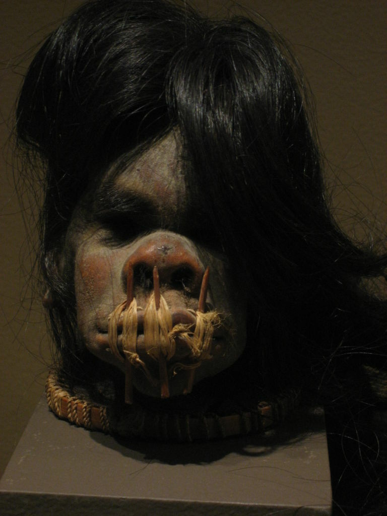 The newest Bowers Museum exhibit includes two shrunken heads, including this one from Ecuador in the early 20th century.  The warrior created the head from a rival killed in battle.  The warrior sewed the mouth shut to keep in - and carry around - the rival's power.