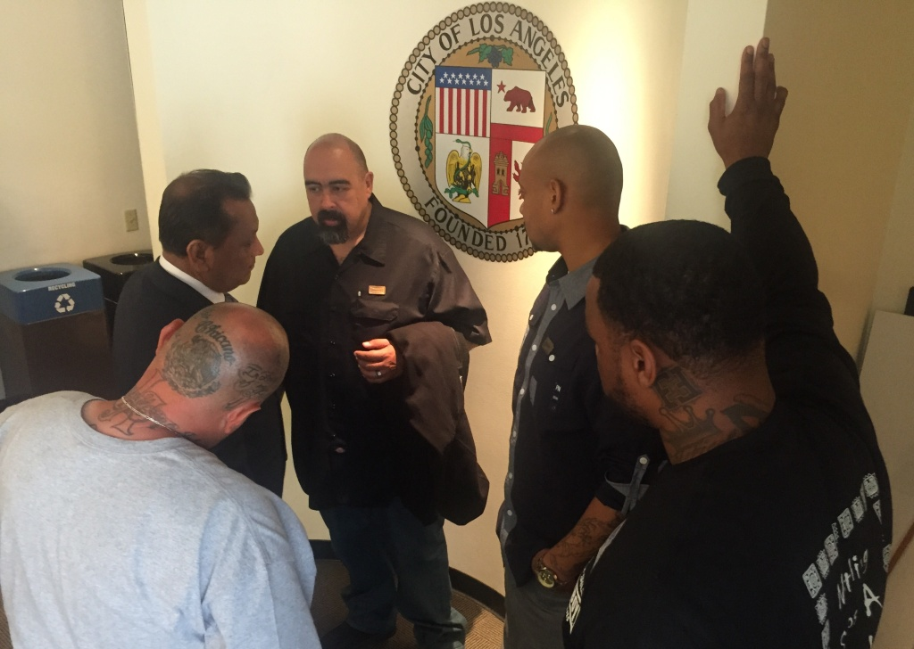 Jose Osuna (middle) and trainees of Homeboy Industries meet with Councilman Gil Cedillo after a minimum wage vote.