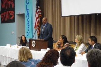 Dr. Robert Ross of the California Endowment addresses the crowd at an event for the Boyle Heights Promise Neighborhood Initiative. The initiative is applying to receive federal funding to improve the neighborhood over the next five years.