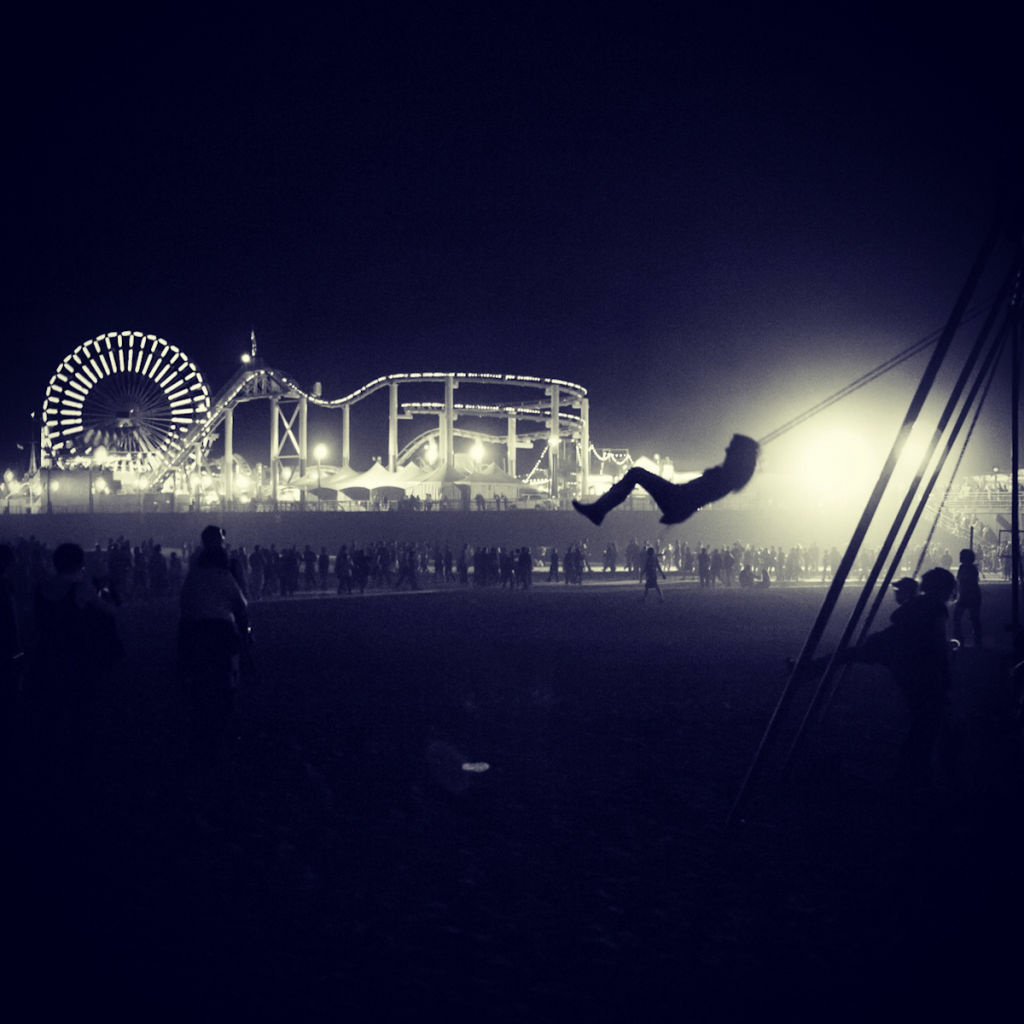 A girl rides a swing at the Santa Monica Pier during Glow, a night festival featuring art installations on the pier. Taiyo Watanabe (@mello_yello)'s picture won our Fleeting Glance Instagram contest.