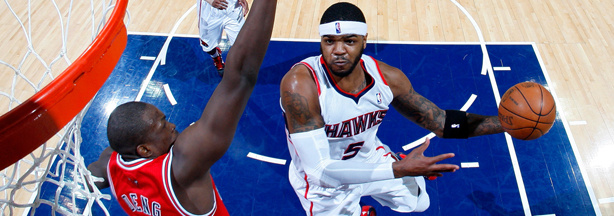 Josh Smith #5 of the Atlanta Hawks, a team now owned by Alex Meruelo, drives against Luol Deng #9 of the Chicago Bulls in Game Six of the Eastern Conference Semifinals in the 2011 NBA Playoffs at Phillips Arena on May 12, 2011 in Atlanta, Georgia.
