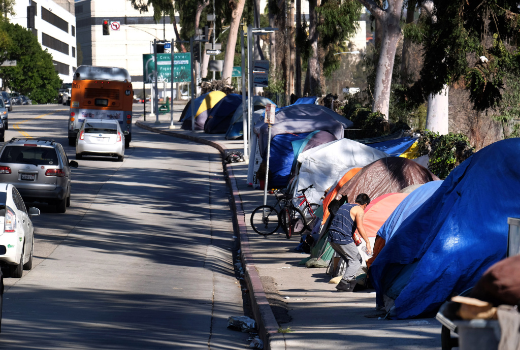 FILE - This Tuesday, Jan. 26, 2016 file photo shows tents from a homeless encampment line a street in downtown Los Angeles.