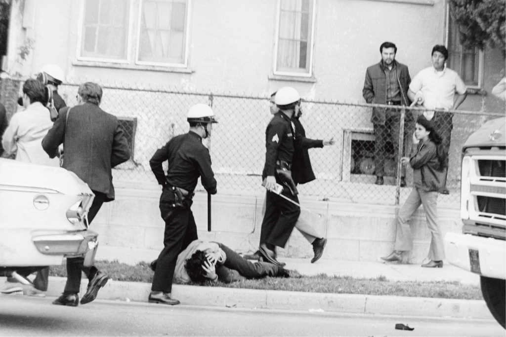 "Boyle Heights, 1968. ""Some kid got hit on the head by the cops during the Walkouts. I called these images 'a field day for the heat.' They were just kids."""
