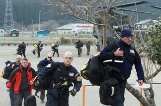 US and British relief staff arrive for rescue operations in the town of Sumita in Iwate prefecture on March 14, 2011 three days after a massive 8.9 magnitude earthquake and tsunami devastated the coast of eastern Japan.