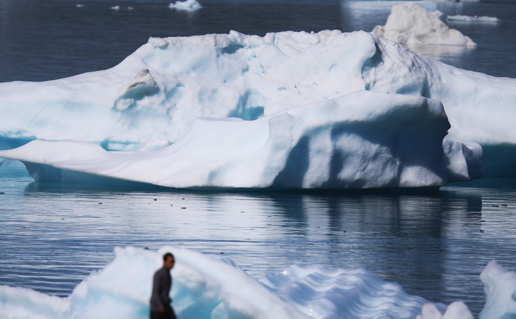 Icebergs are seen floating in the water on July 30, 2013 in Narsaq, Greenland.