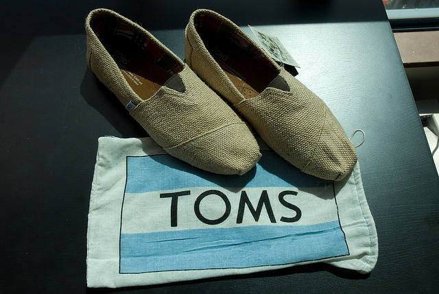 A pair of burlap TOMS shoes. Is the for-profit organization's