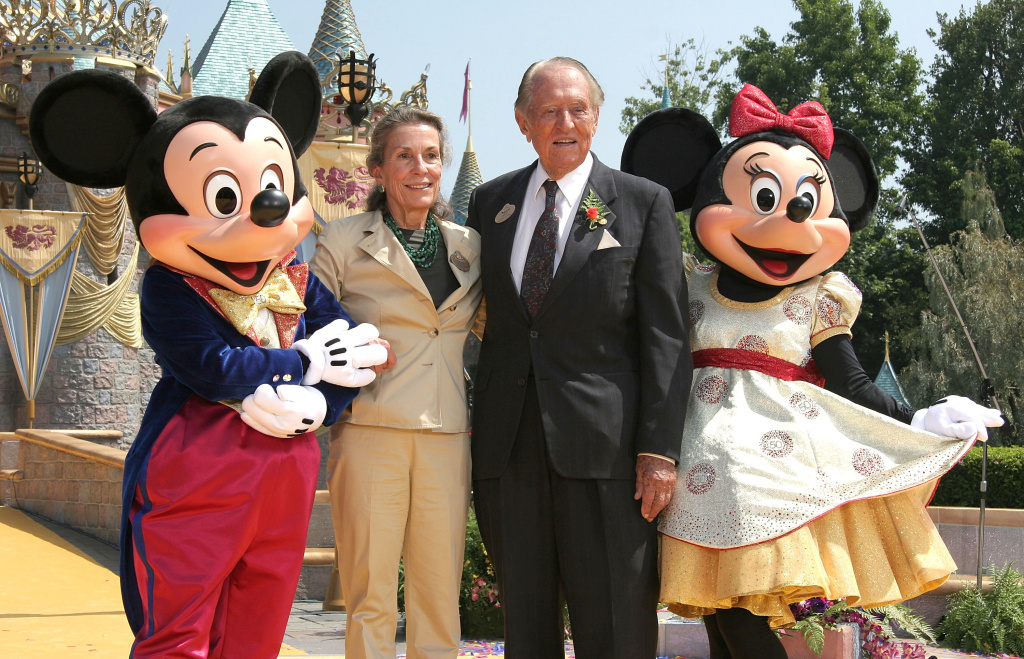 Diane Disney Miller, daughter of Walt Disney poses with actor Art Linkletter, Mickey and Minnie Mouse at Disneyland's 50th Anniversary rededication ceremony held at Disneyland on July 17, 2005 in Anaheim, California.