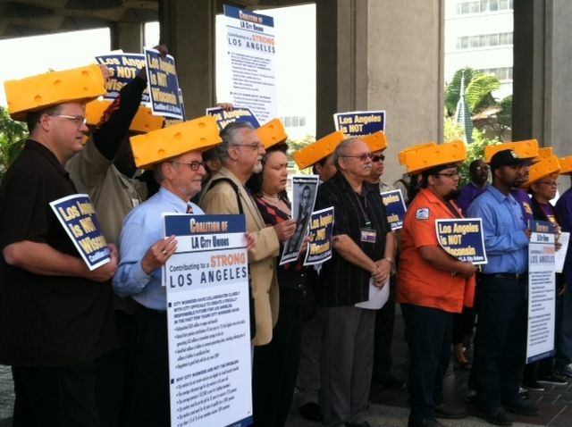 Members of the Coalition of L.A. City Unions protested the city's pension reform plan. They wore cheesehead hats as they likened Mayor Antonio Villaraigosa's treatment of union workers to that of Wisconsin Gov. Scott Walker.