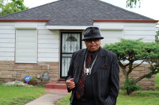 File photo: Joe Jackson stands in front of the Jackson family's old home in Gary, Indiana on June 2, 2010.