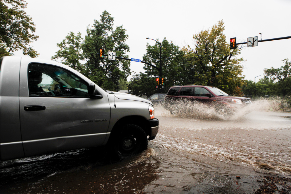 Motorists attempt to drive through downtown Boulder after three days of heavy rainfall September 12, 2013 in Boulder, Colorado. An estimated 6-10 inches of rain fell in 12-18 hours and more is expected throughout the day. Flash flood sirens warned people to stay away from Boulder Creek and seek higher ground.