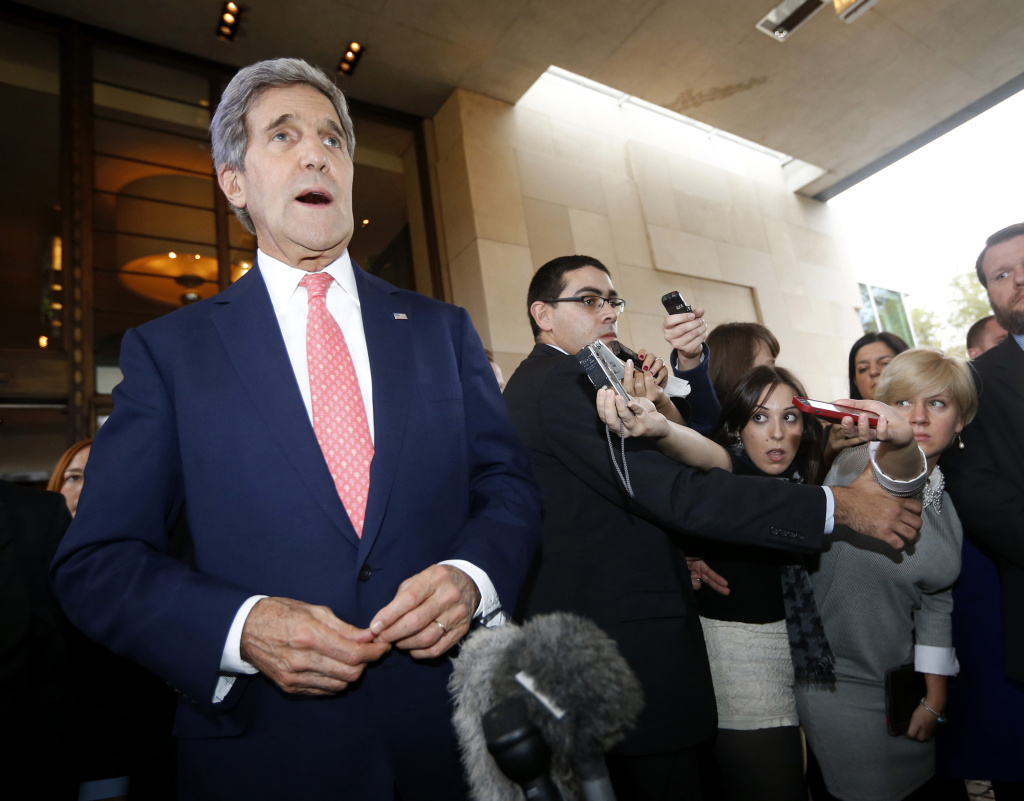 US Secretary of State John Kerry speaks to the press upon his arrival in Geneva on November 8, 2013, on the second day of talks with Iran on their nuclear programme. World powers and Iran have yet to reach a deal on Iran's nuclear programme but are working hard to do so, US Secretary of State John Kerry said on November 8.