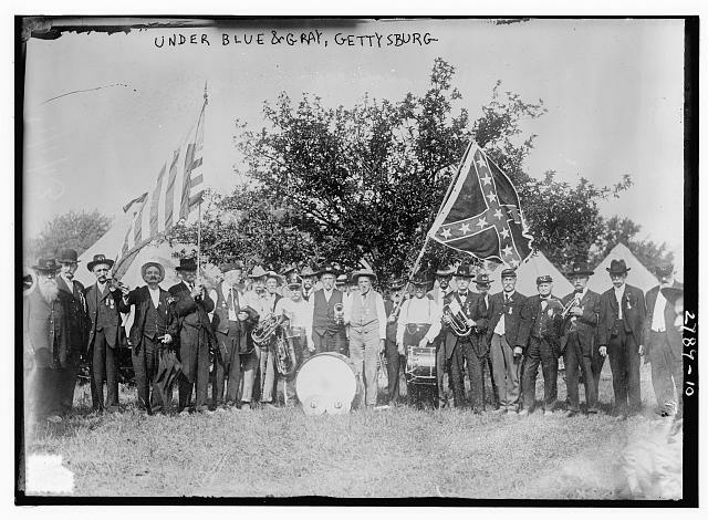 Veterans of the Union and Confederate armies march at the encampment in July 1913 during the Great Reunion, commemorating the 50th anniversary of the Battle of Gettysburg