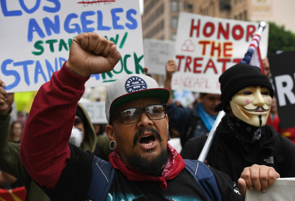 Demonstrators march to the Federal Building in protest against President Donald Trump's executive order fast-tracking the Keystone XL and Dakota Access oil pipelines, in Los Angeles, California on February 5, 2017.