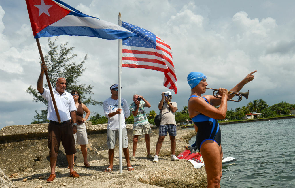 US swimmer Diana Nyad (C) plays a bugle before her departure from the Ernest Hemingway Nautical Club in Havana on August 18, 2012.