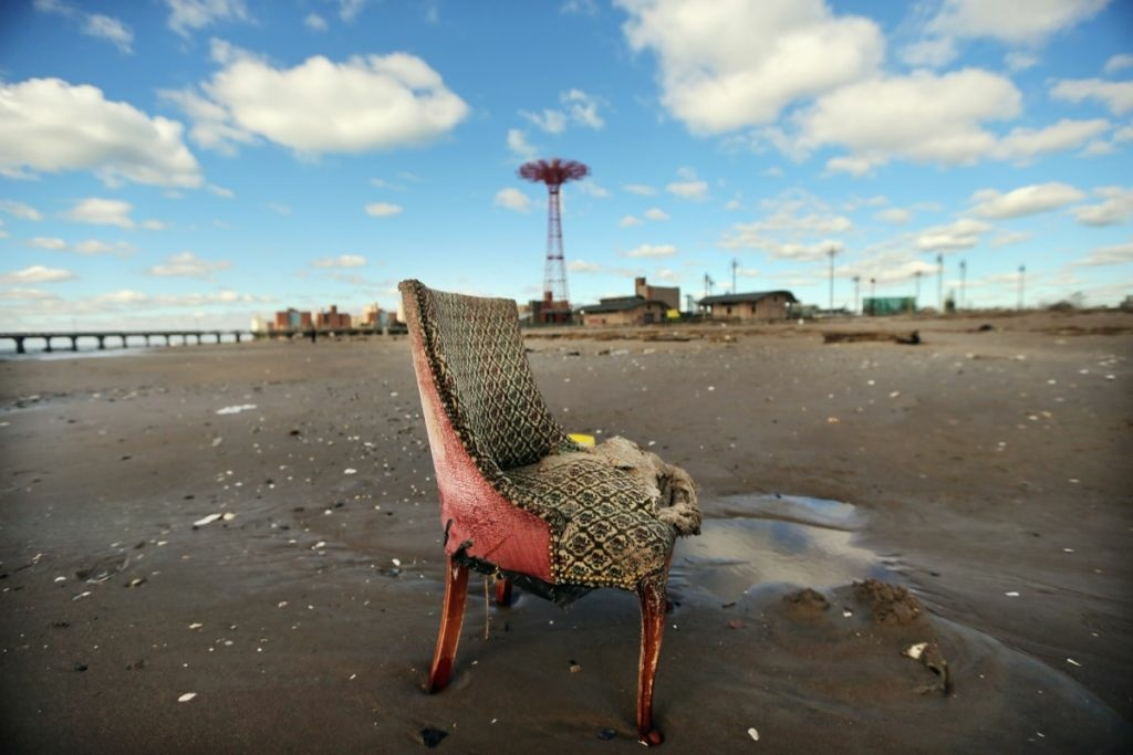 A damaged chair sits on the beach in low-lying Coney Island in the wake of Superstorm Sandy on Nov. 3, 2012 in the Brooklyn borough of New York City.