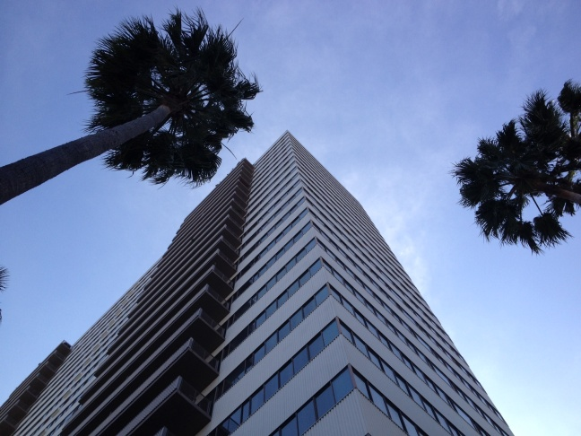 LA City Fire Inspector points out older high-rise buildings without fire sprinklers at Wilshire Blvd. and Selby Ave.
