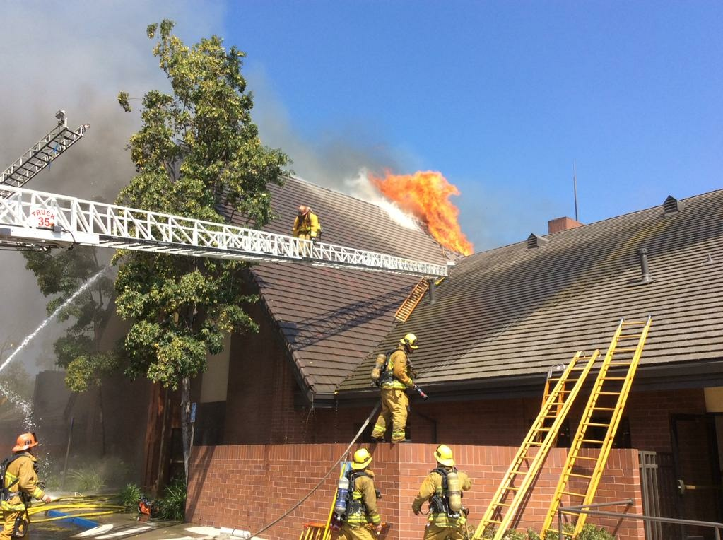 A brush fire in Glassell Park spread to the roof of a nearby church on Tuesday, July 7, 2015.